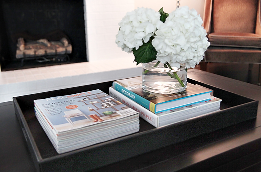 coffee table, tray, flowers, books