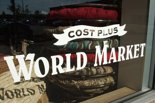 Cost Plus World Market sign in store window left CC A WHOLE NEW WORLD