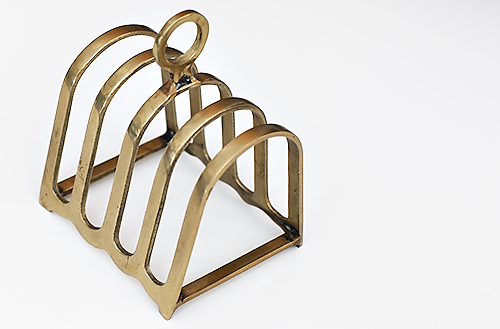 Use a vintage toast holder to organize small things on your desk. // 7thhouseontheleft.com